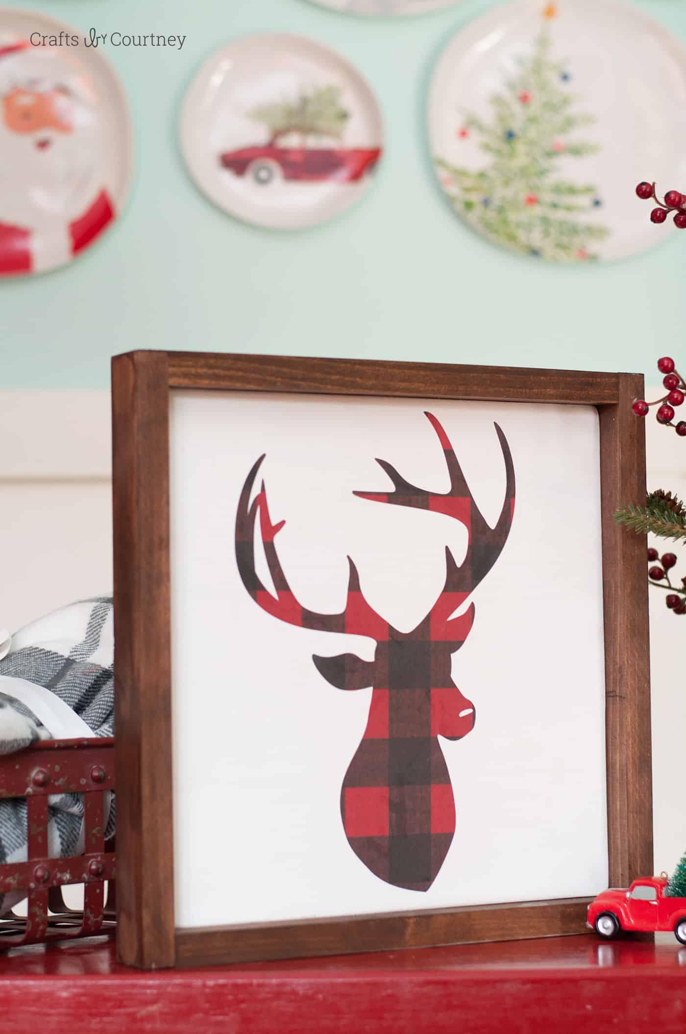 Handmade DIY Christmas sign featuring a buffalo plaid deer