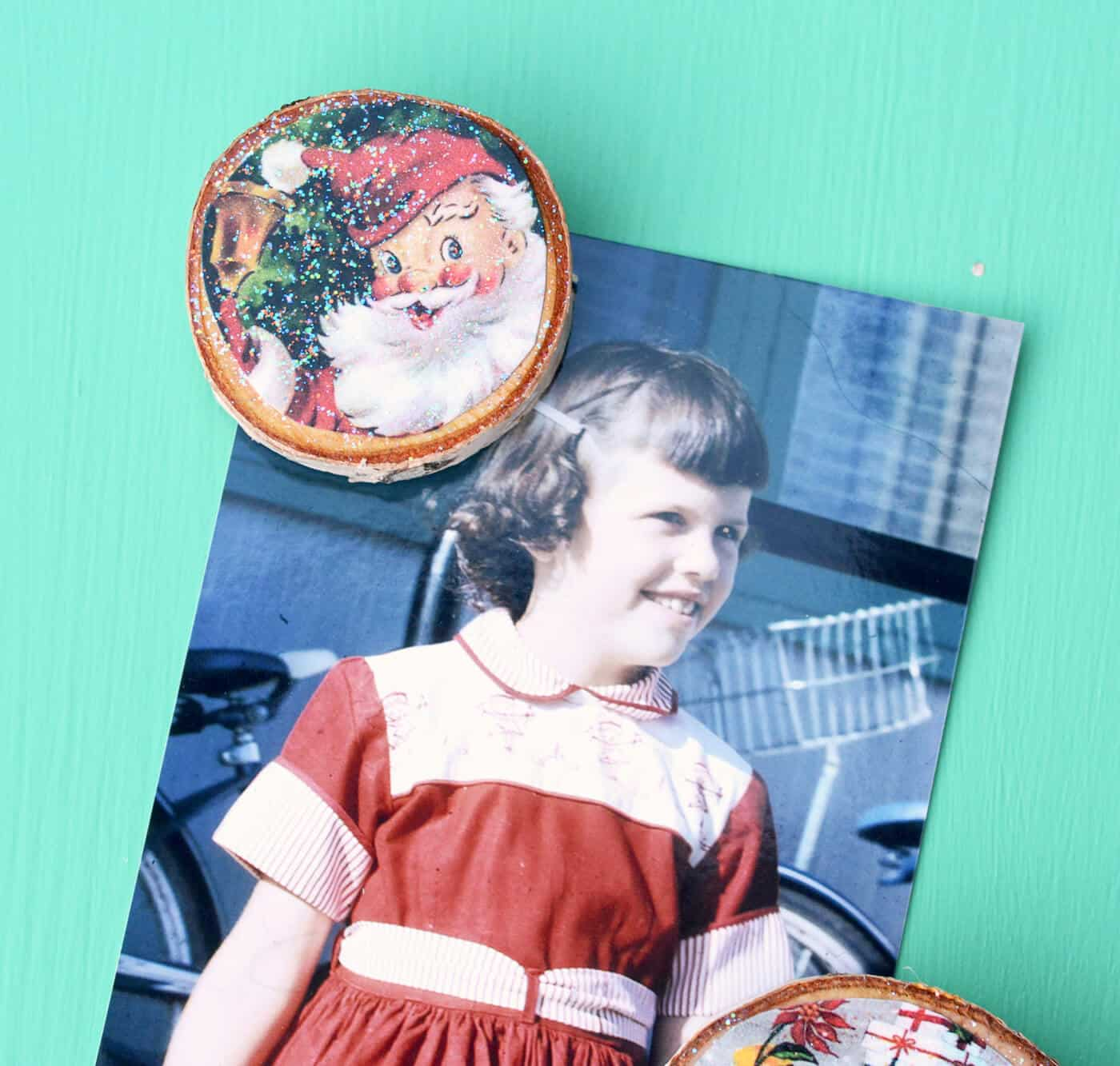 Learn how to make sparkly Christmas magnets with Mod Podge on wood slices