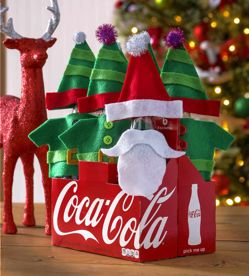 Dress up some Coke bottles with this fun Santa and elves gift! Makes a perfect gift idea for a neighbor; easy to make with this free template and tutorial.