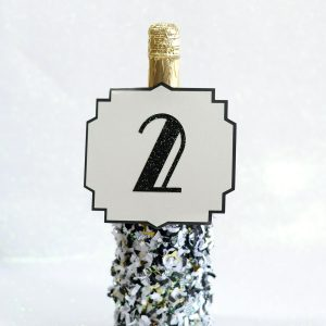 Party confetti dipped NYE champagne bott...