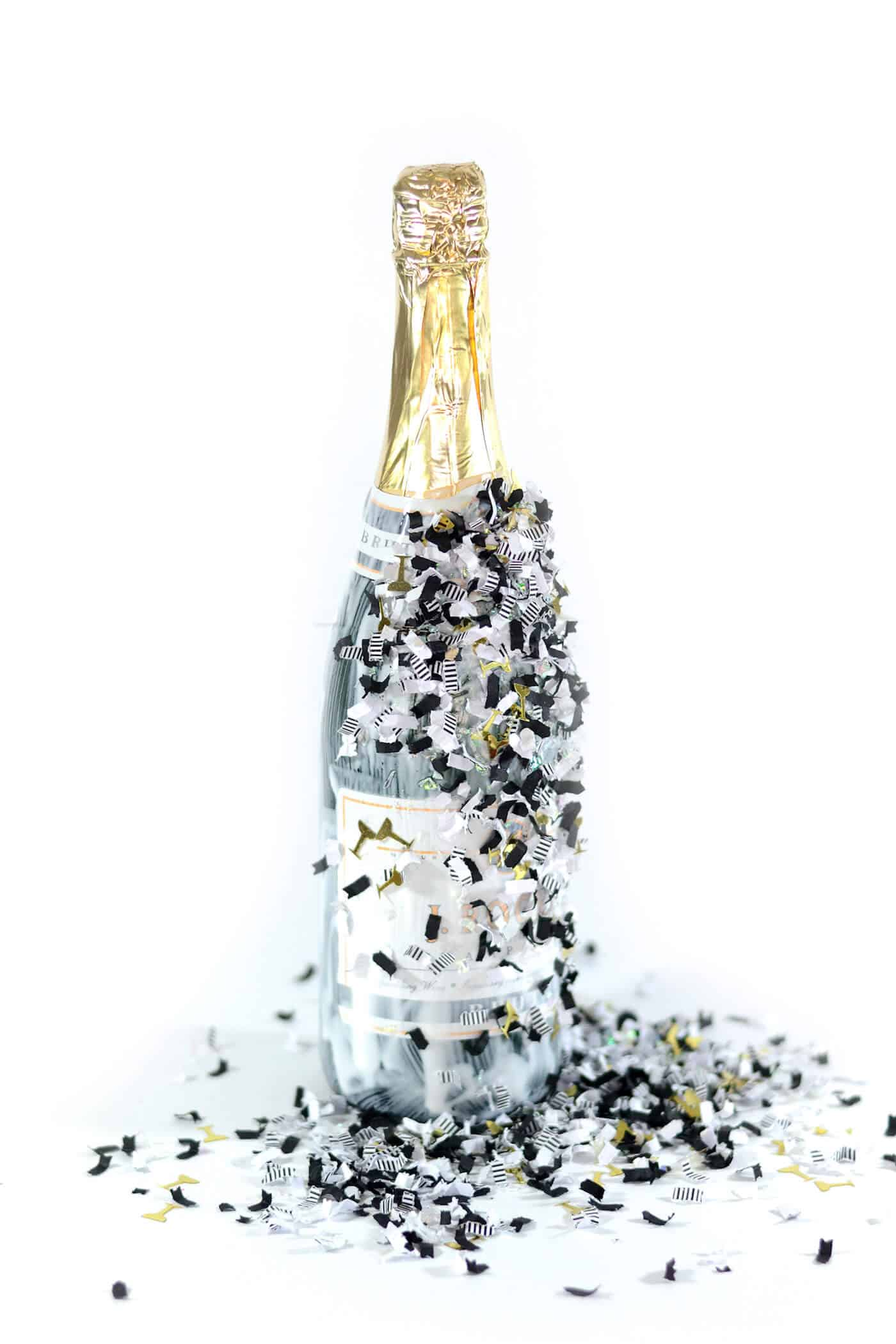 Party confetti dipped NYE champagne bottle - Mod Podge Rocks