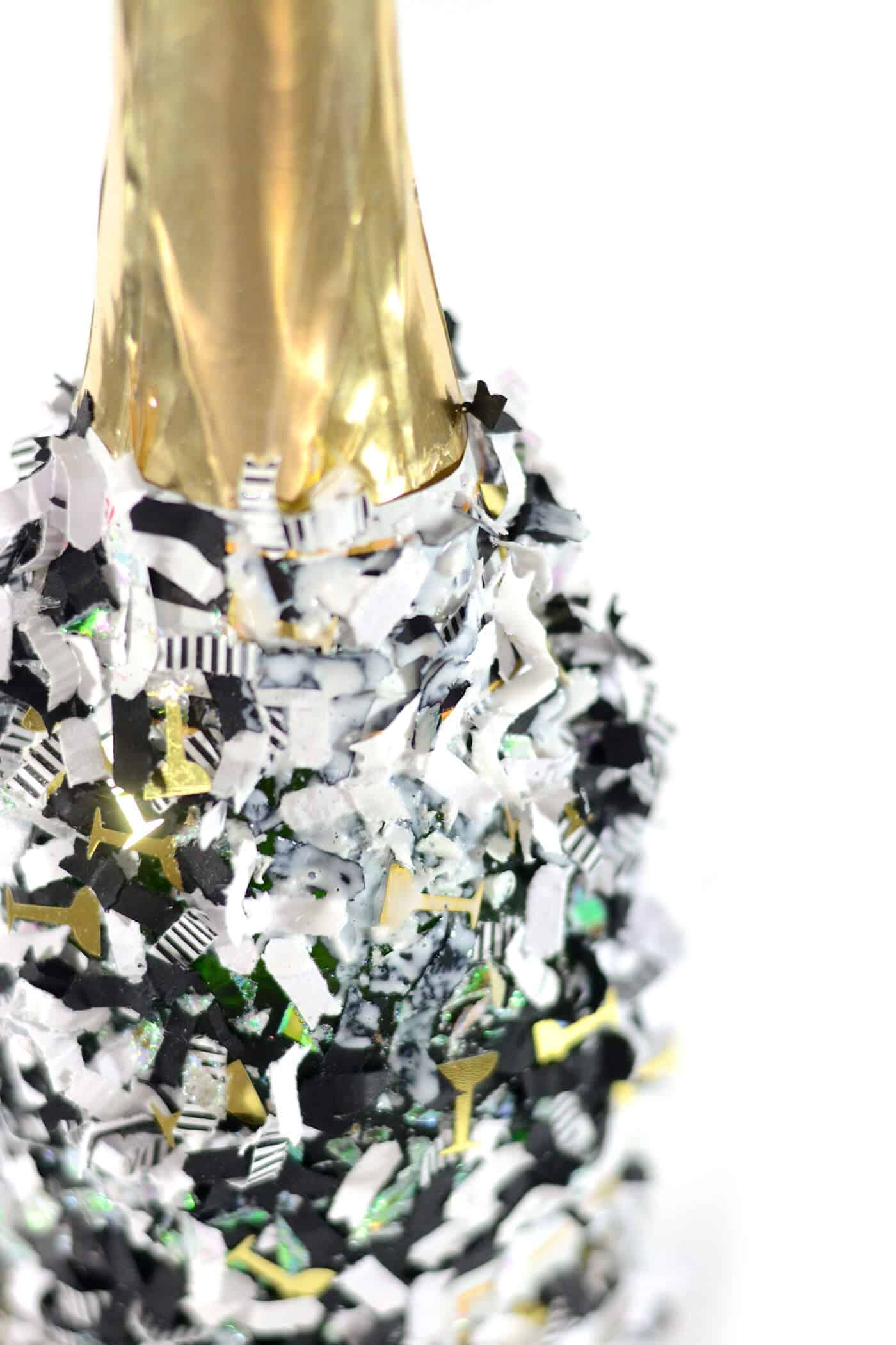 Confetti sprinkled on a champagne bottle