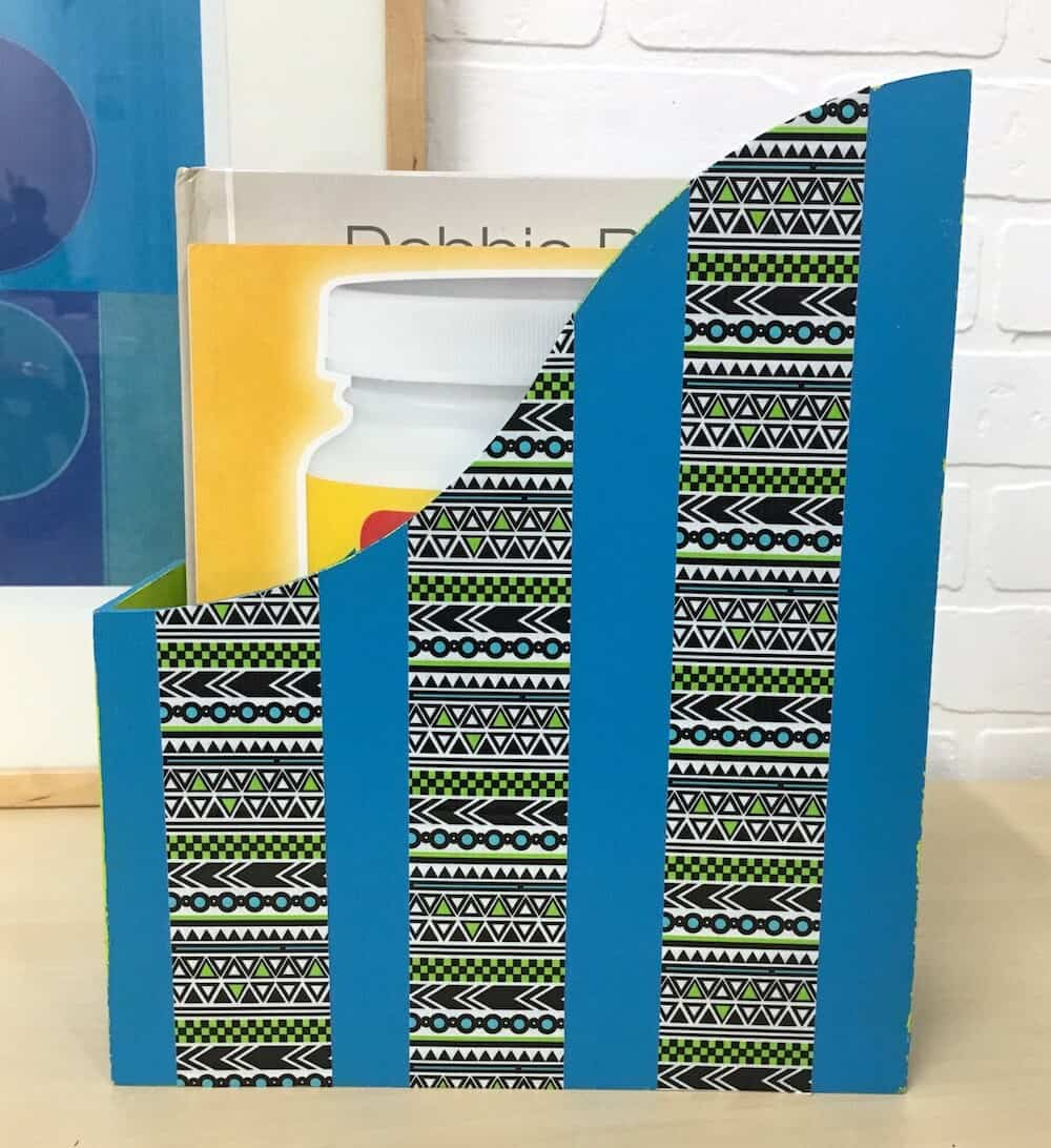 Grab some wooden magazine racks from IKEA and paint them as gifts! Add your favorite Duck Tape - including their chalkboard type - to personalize.