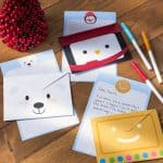 Do you love free Christmas printables? Grab this darling holiday stationery set with paper and envelopes! Get gift tags and a printable decor sheet too.