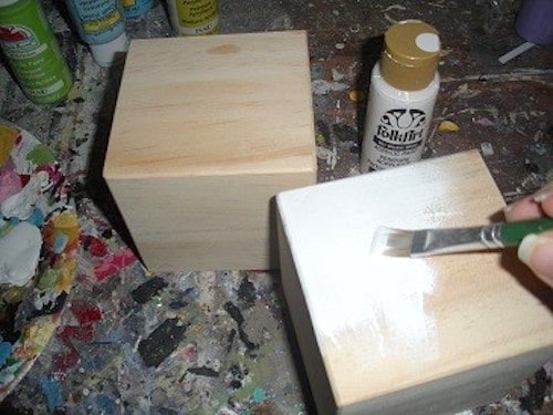 Painting a wood block with white acrylic paint