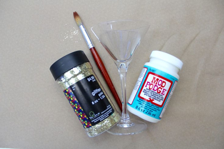 Glitter, paintbrush, martini glass, and Dishwasher Safe Mod Podge