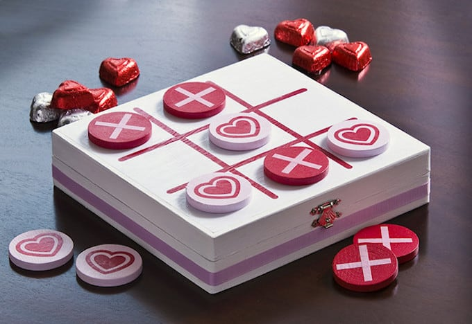 This cute Valentine's Day tic tac toe game was made using a wood box and other supplies from the craft store. Makes a great gift!
