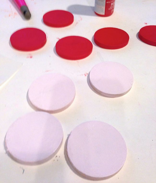 Painted tic tac toe wood circles in red and pink