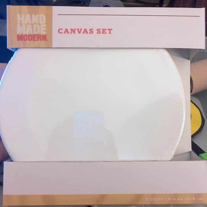 Are you wondering how to decoupage napkins on canvas? Learn how to do it with this emoji canvas project. Such a fun idea and very easy!