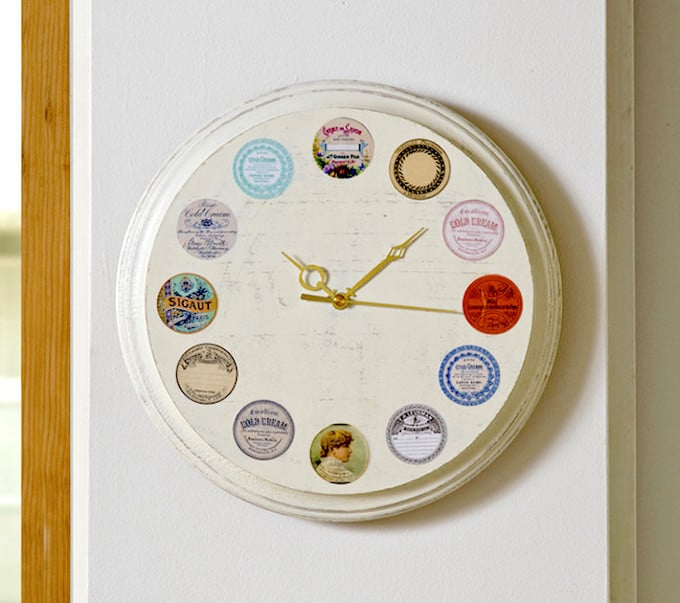 This DIY wall clock is easy to make, using vintage inspired labels and Mod Podge. Follow this tutorial and create your own version!
