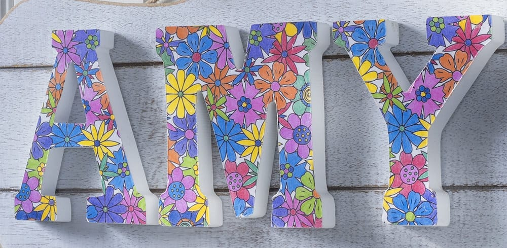 Use your adult coloring pages to make this personalized DIY name plaque! Relax and enjoy coloring then turn them into something pretty for your wall.