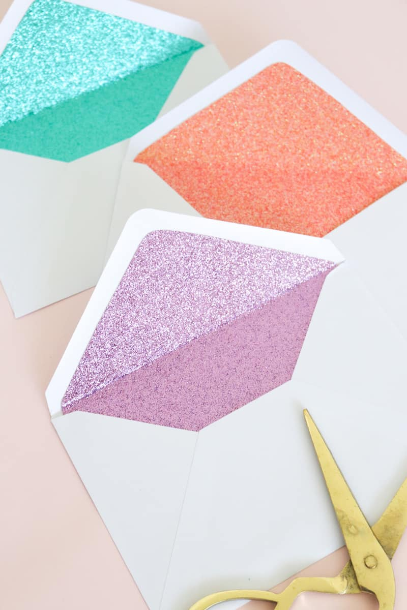 These DIY glitter lined envelopes are easy to make and add a surprise pop of color when the envelope is opened! Perfect for party invitations.