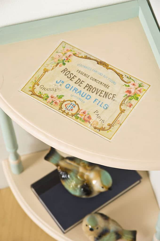 Try an upcycled furniture project with this piece from the Goodwill - this table was made over with paint, Mod Podge photo transfer and a vintage graphic!
