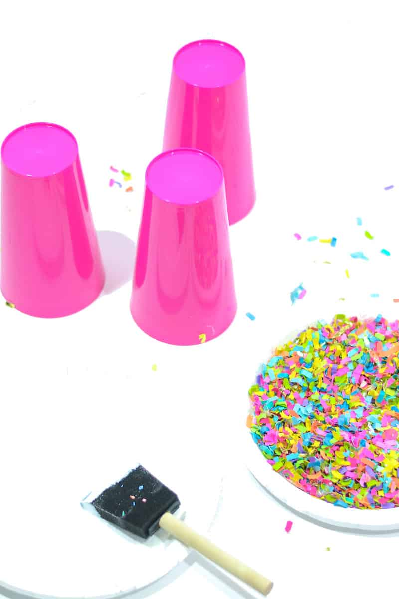 These budget friendly party cups are dipped in confetti! If you need some easy decor for your next celebration, get the tutorial here.