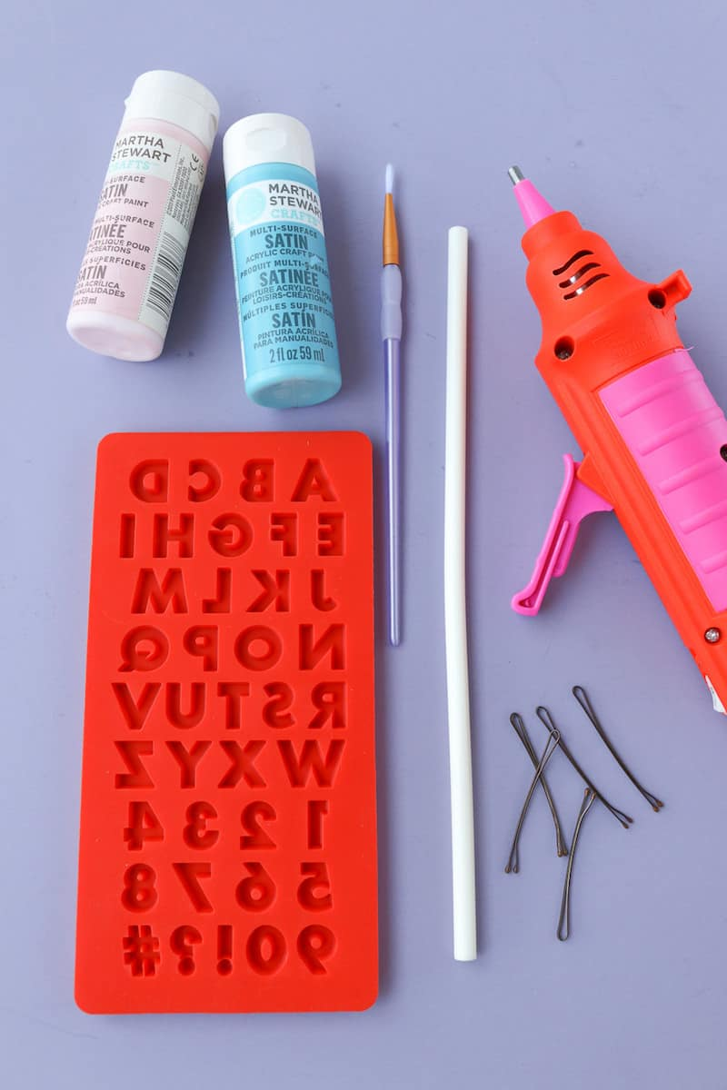 Use Mod Melts and Molds to create your own graphic DIY hair pins! Make them with the sayings and paint colors of your choice. SO easy.