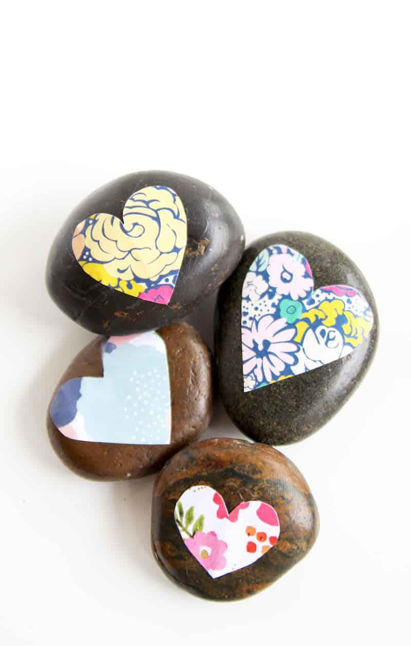 Decorate some pretty stones for your garden or desktop with a little bit of decoupage. It's easy to Mod Podge on rocks and the results are so pretty!