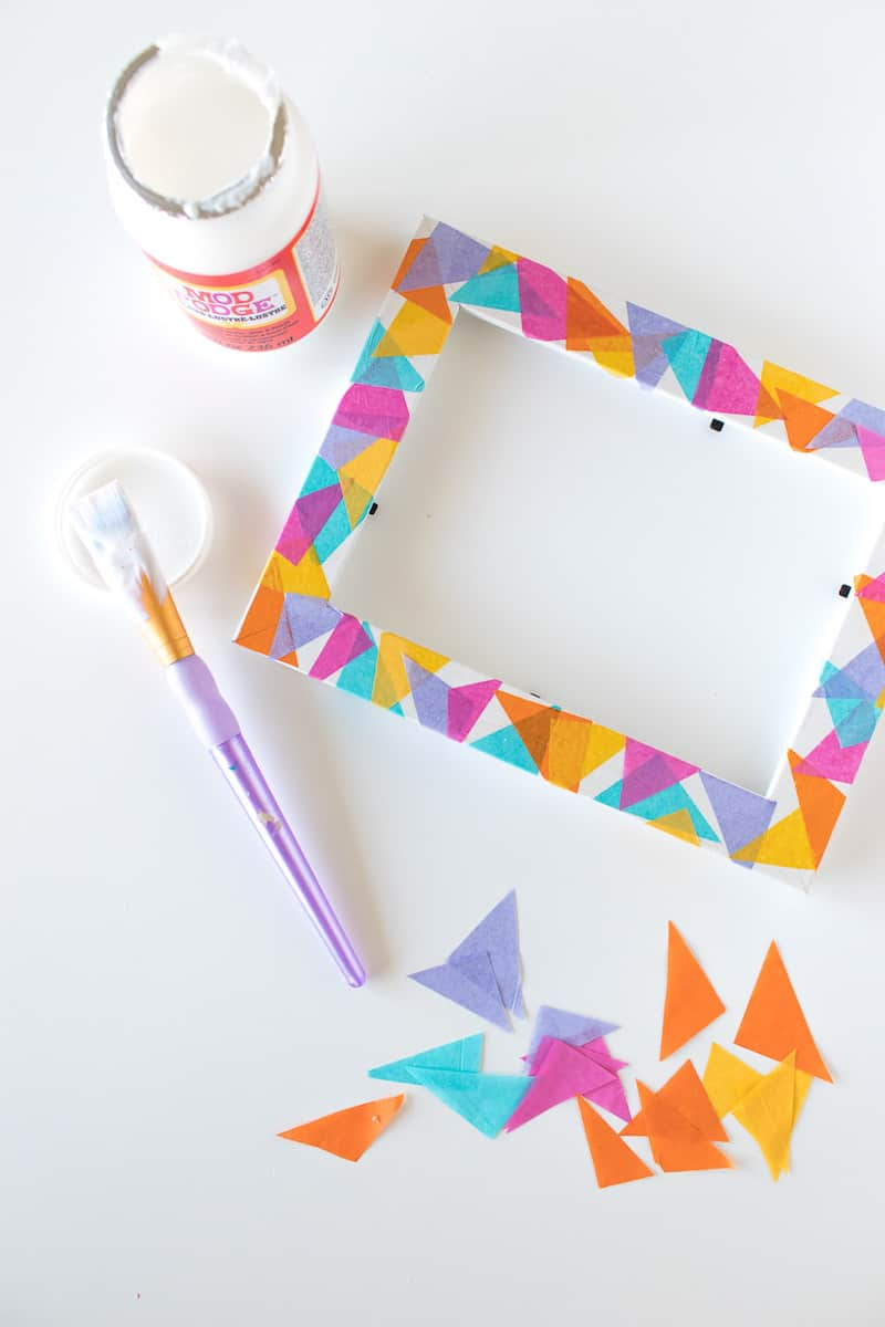This tissue paper frame is perfect for whipping up quickly and adding color to your home. So easy, even a child can do it!