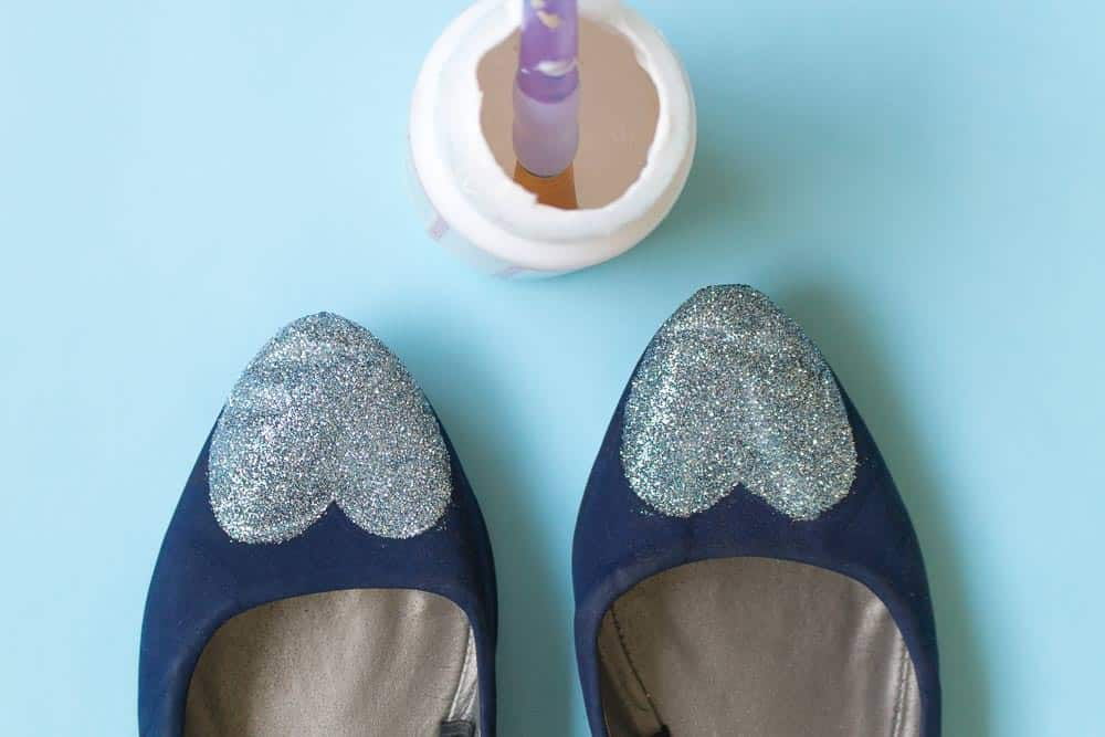 Instead of throwing away an old pair of kicks, learn how to revamp them with Mod Podge and glitter in this decoupage shoes project!