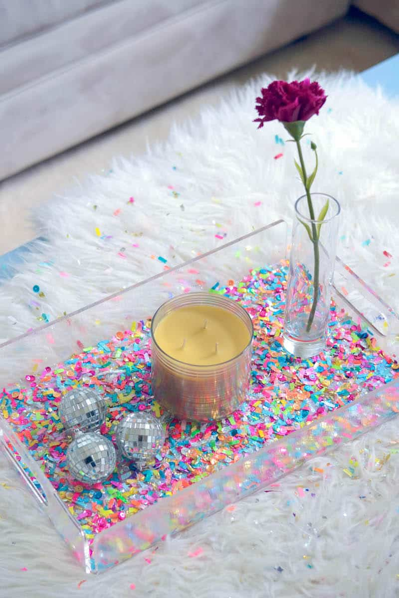 Ready to party?? You can decorate a clear acrylic tray with confetti and Mod Podge. This confetti tray is easy and perfect for a celebration or home decor.