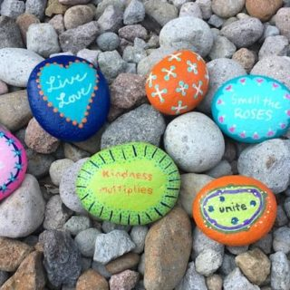 Kindness Rocks on a bed of rocks