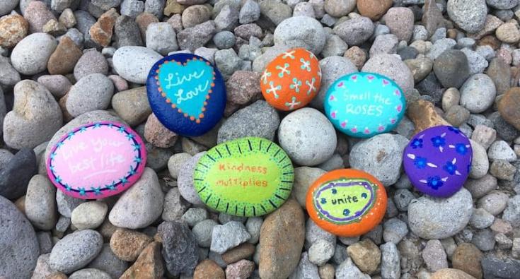 Kindness Rocks on a bed of rocks