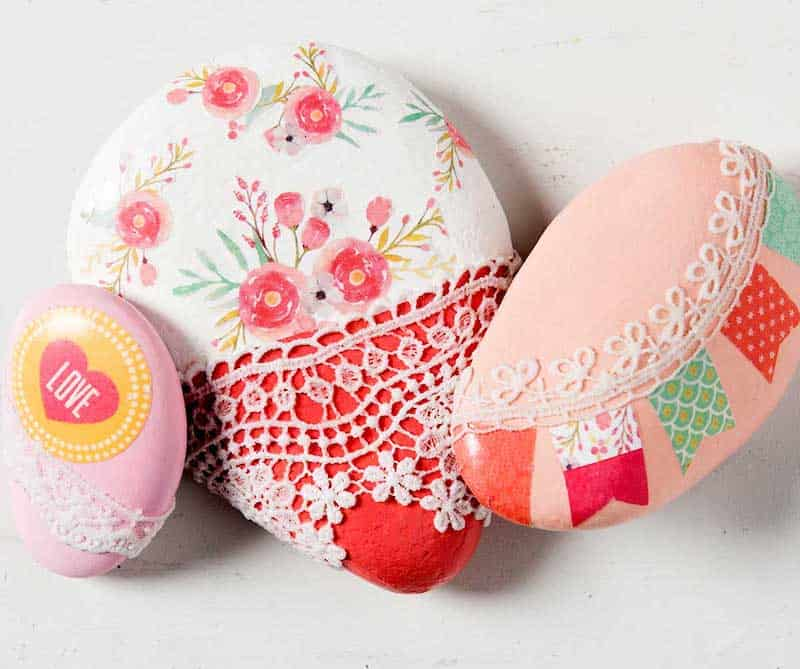 Rocks decorated with scrapbook paper and lace