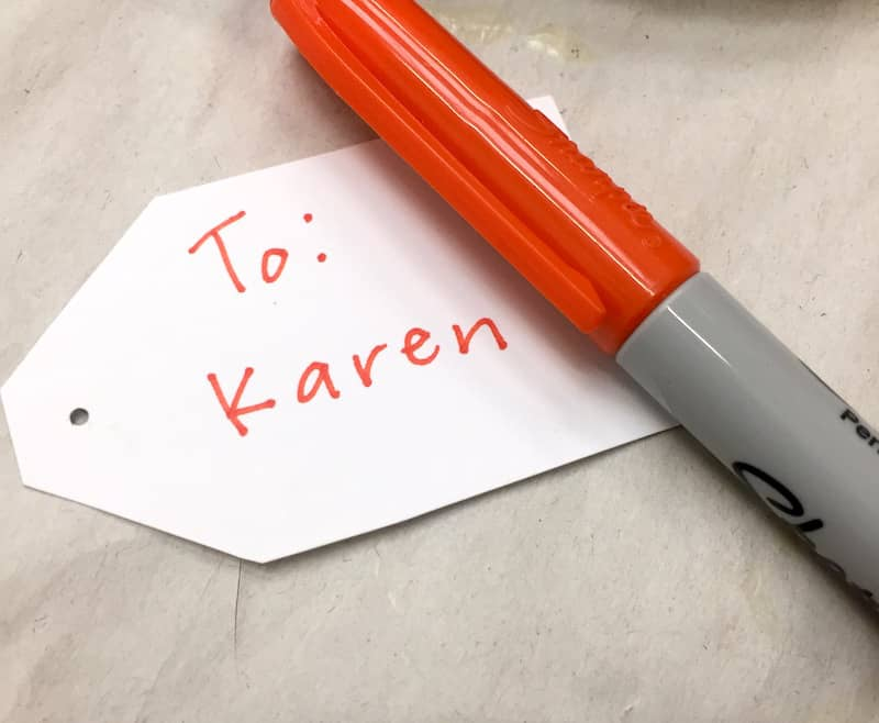 Writing on a gift tag with Sharpie