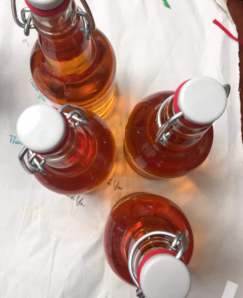 Cider bottles filled with apple cider