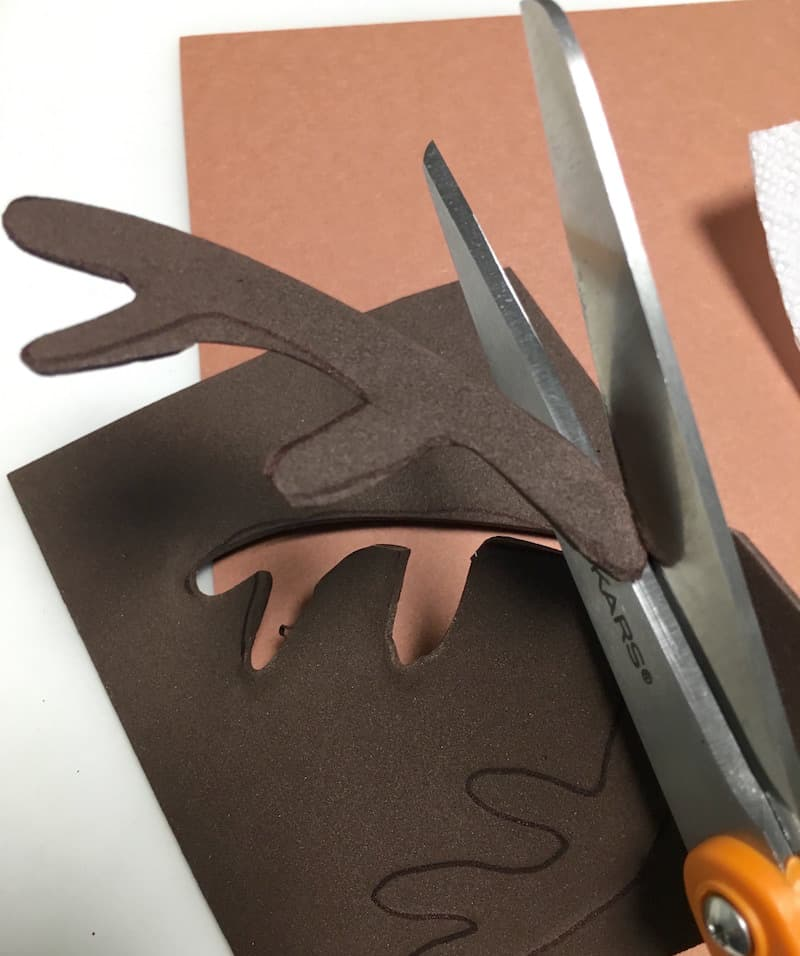 Cutting antlers out of craft foam using scissors