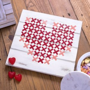 Make this simple and pretty Valentine's Day art using a wood pallet and Duck Tape! So easy, even a kid can do it. Use this cross stitch idea for a variety of designs.