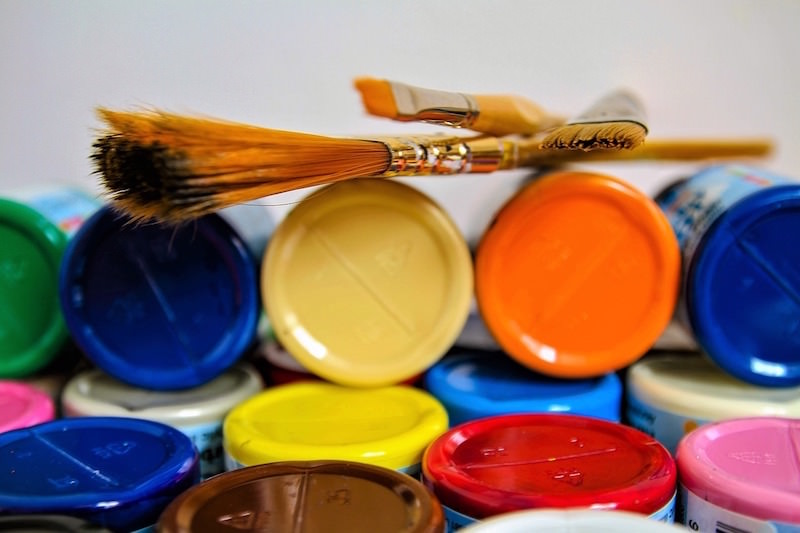Brushes on top of craft paint bottles