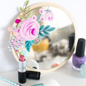 This is the easiest method ever to decorate a mirror! Add a little DIY flair with Mod Podge and your favorite wrapping paper or napkins, then finish with a wood background. Learn how here!
