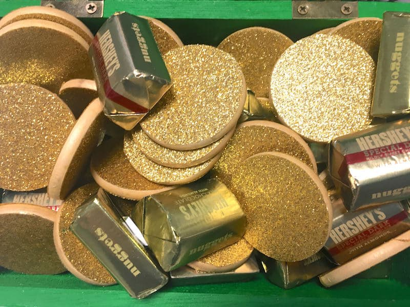 Gold coins with Hershey's nuggets candy in a St. Patrick's Day chest