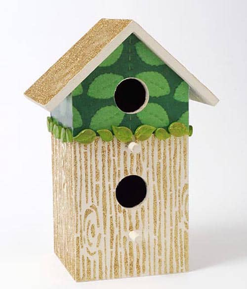 Decorate birdhouses with stencils and glitter
