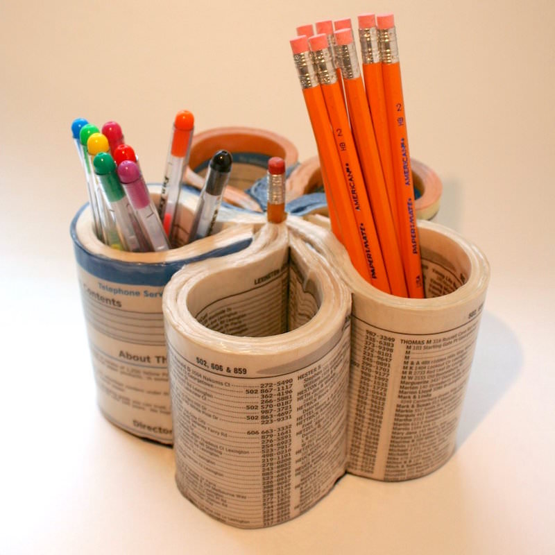 Phone book turned to a pencil cup