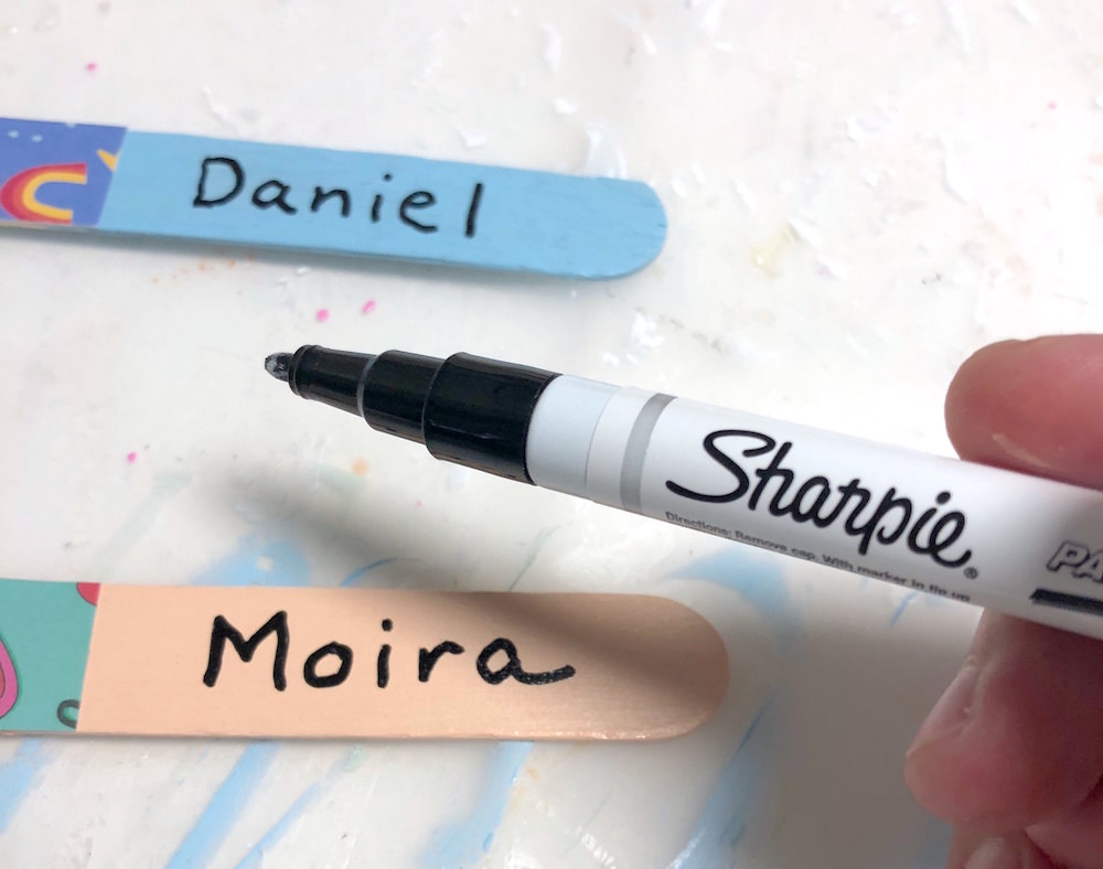 Write on popsicle sticks with a Sharpie