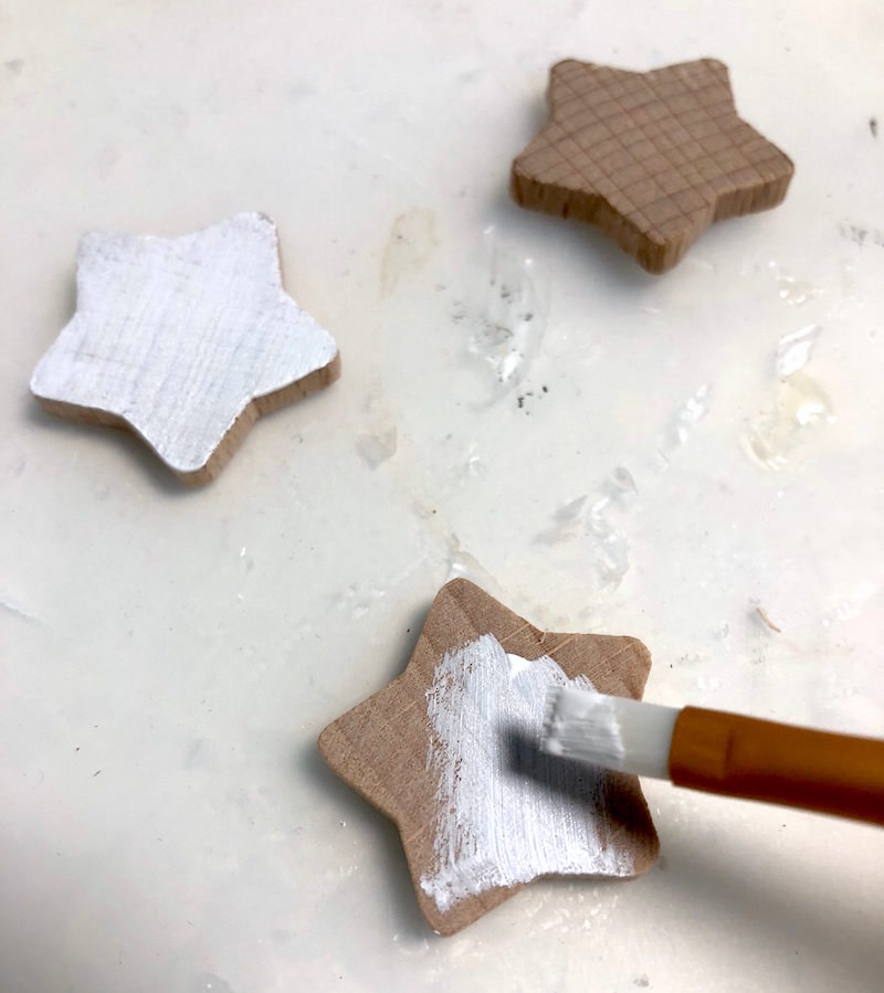 Painting wooden stars with white acrylic paint