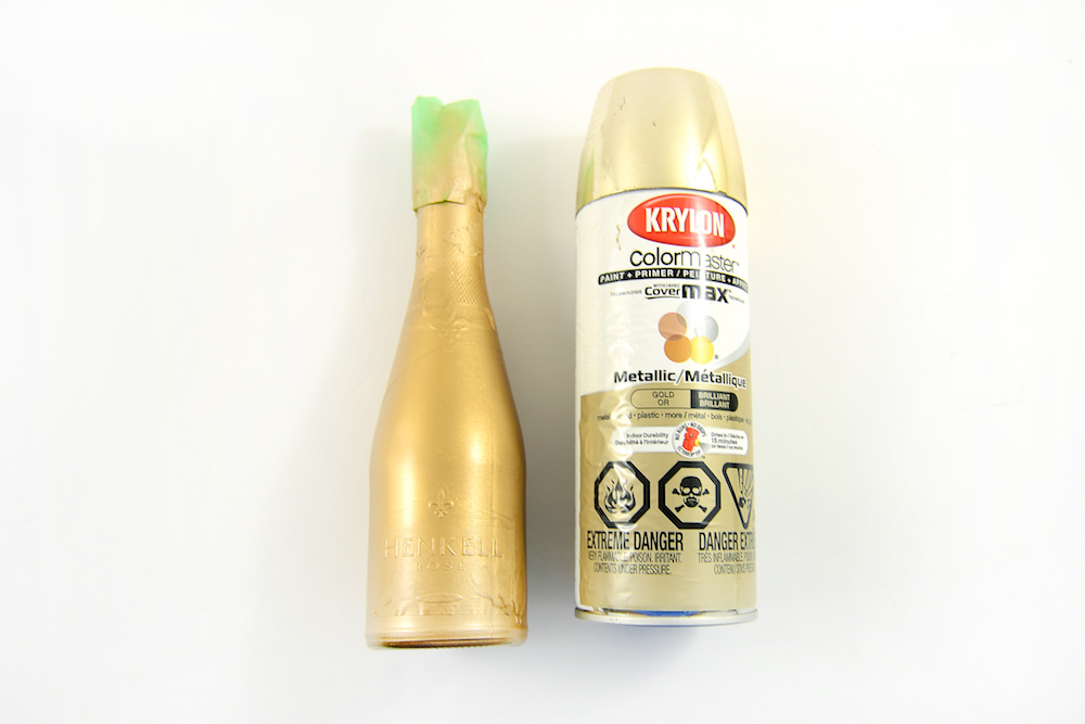 Spray paint the mini champagne bottles