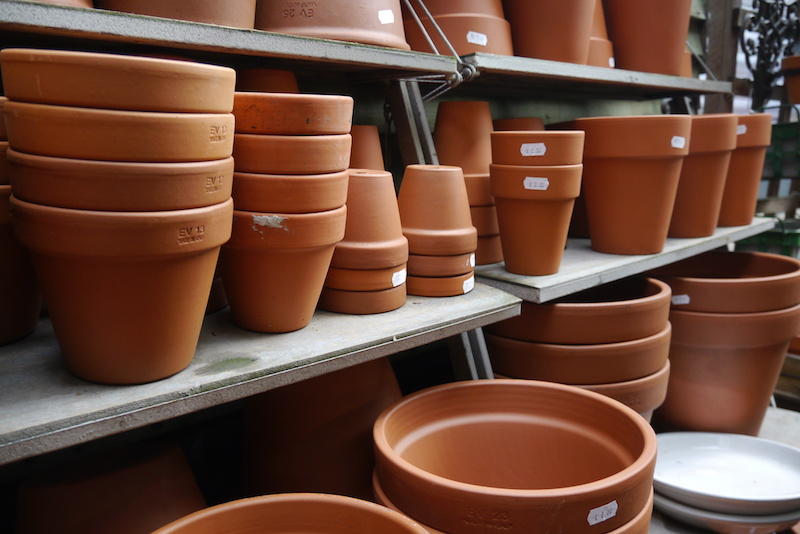 clay pots stacked on a shelf