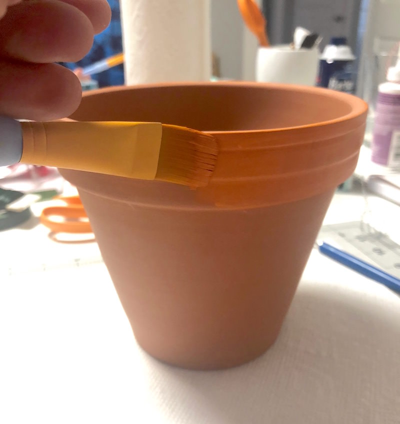 Paint the lip of a clay pot