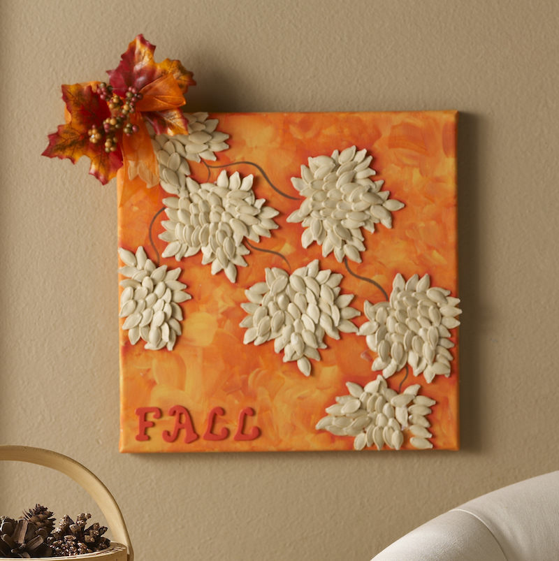 Make a fall canvas with pumpkin seeds