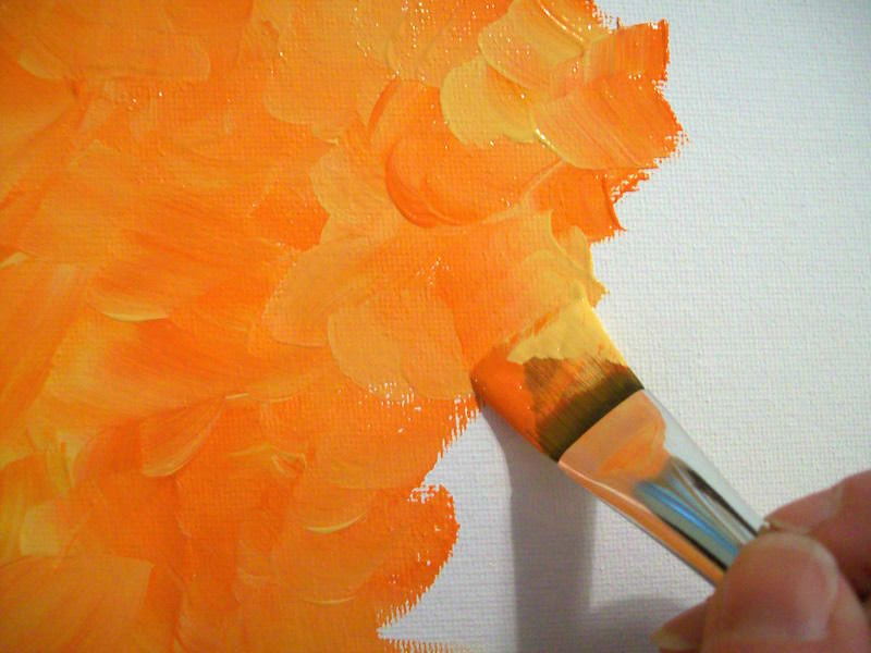 Double loaded brush with orange and yellow