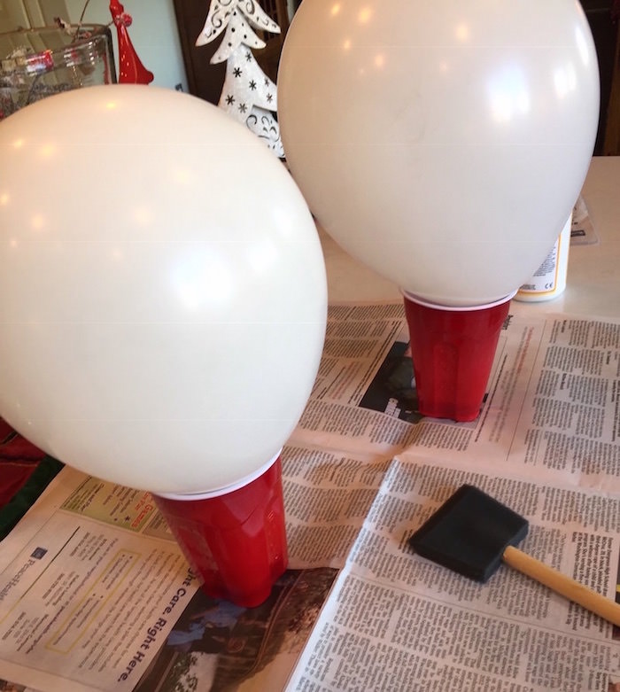 Blow up balloons and place in cups