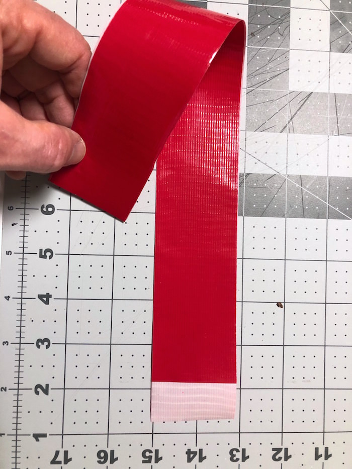 Bending two pieces of red Duck Tape stuck together