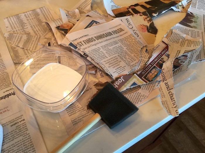 Tear up newspaper