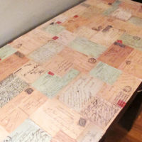 Decoupage desk with postcards