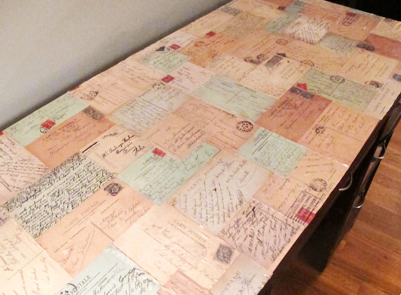 Decoupage desk with postcards