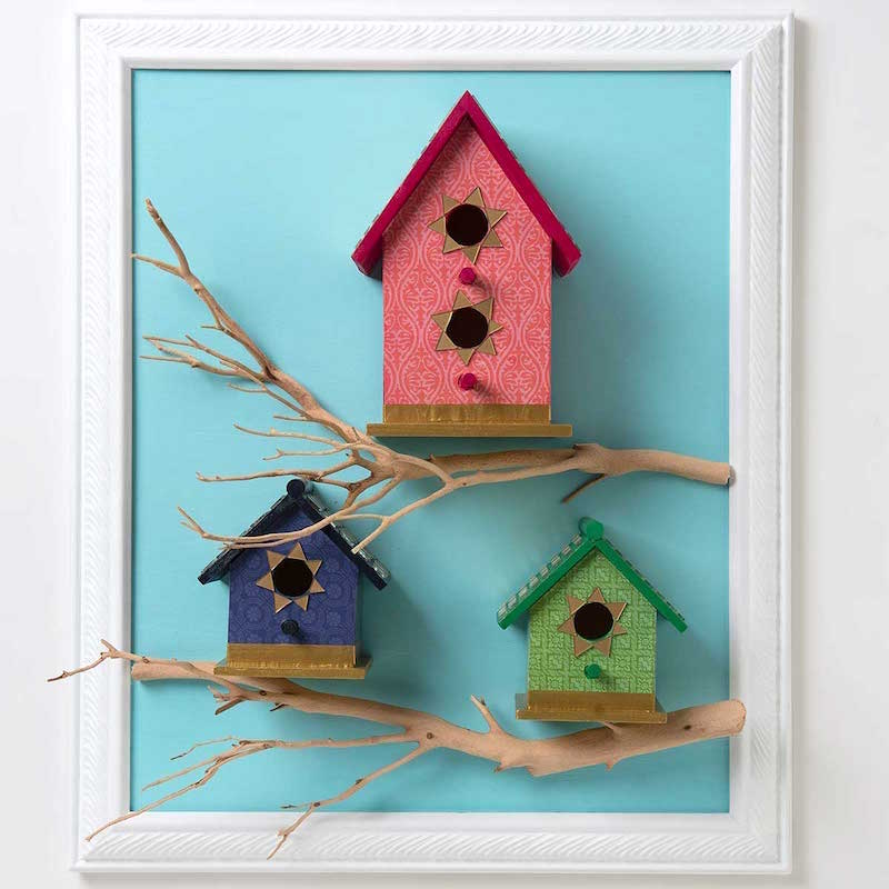 Tiled birdhouse in a frame