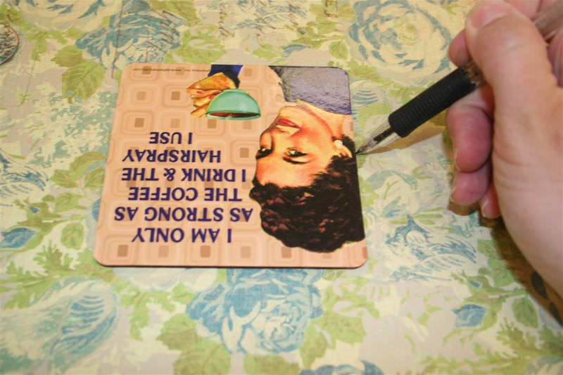 Trace a square onto a piece of scrapbook paper with a pencil
