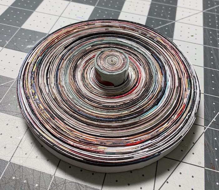 Coiled lid for a paper bow